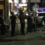 New Orleans Street Musicians Perform Second Line on Street Corner Outside the Jazz Clubs at Night